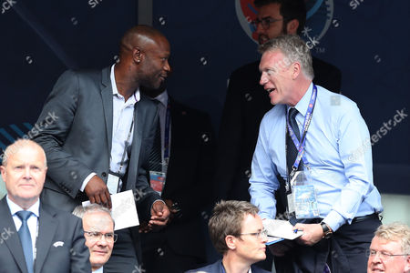 William Gallas and David Moyes talk in the stands during the UEFA Euro 2016 Group F match between Iceland and Austria played at Stade de France, Paris, France on June 22nd 2016