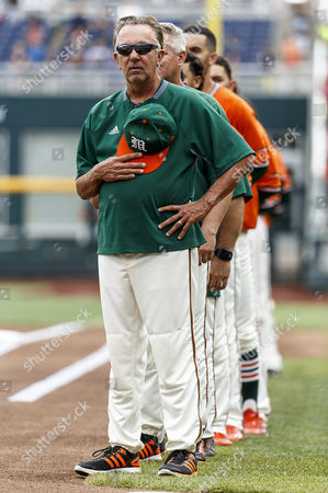 Miami head coach Jim Morris stands during the National Anthem before game 5 of the NCAA Men's College World Series between Miami Hurricanes and UC Santa Barbara Gauchos at TD Ameritrade Park in Omaha, NE