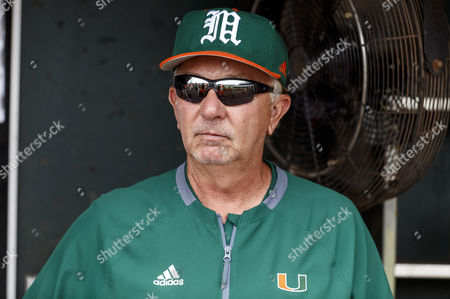 Miami head coach Jim Morris sits in his dugout before game 5 of the NCAA Men's College World Series between Miami Hurricanes and UC Santa Barbara Gauchos at TD Ameritrade Park in Omaha, NE