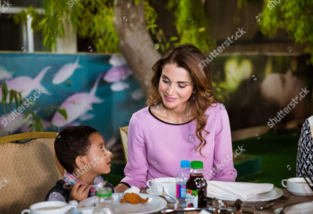 Stock Picture of Queen Rania and Princess Iman bint Abdullah visited the Al Hussein Social Foundation for Orphans, breaking the fast in the company of orphaned children and their caretakers