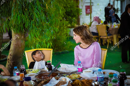 Stock Image of Queen Rania and Princess Iman bint Abdullah visited the Al Hussein Social Foundation for Orphans, breaking the fast in the company of orphaned children and their caretakers