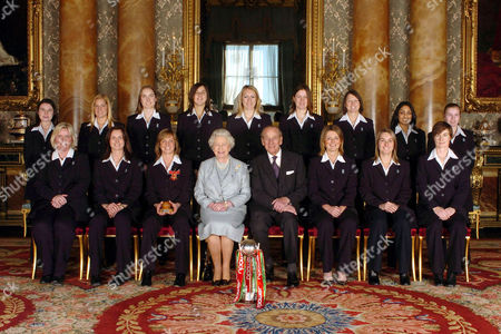 Stock Photo of England's Women's 2005 Ashes winning Cricket team - (back row) Jo Watts, Katherine Brunt, Beth Morgan, Jenny Gunn, Rosalie Birch, Lydia Greenway, Arran Brindle, Isa Guha and Holly Colvin with (front row) Charlotte Dickenson, Laura Newton, captain Clare Connor, Queen Elizabeth II, Prince Philip, vice captain Charlotte Edwards, Jane Smit and Clare Taylor.
