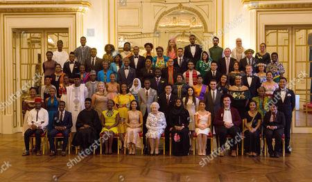 Queen Elizabeth II sits for a group photo with the sixty winners of the Queen's Young Leaders Awards at Buckingham Palace in London. Front row left to right: David Morfaw (Cameroon), Asante Mzungu (Malawi), Olumide Femi Makanjuola (Nigeria), Rachel Nungu (Tanzania), Kelly Lovell (Canada), Queen Elizabeth II, Safaath Ahmed Zahir (Maldives), Annabelle Xerri (Malta), Jacob Thomas (Australia), Seini Fisi'ihoi (Papua New Guinea), Kartik Sawhney (India). Second row: Moitshepi Matsheng (Botswana), Matetsabisa Molapo (Lesotho), Olanrewaju Adeloye (Nigeria), Jessica Dewhurst (South Africa), Deidra Smith, (Belize), Trevis Belle (Saint Kitts & Nevis), Calvin Woo Yoong Shen (Malaysia), Katerina Gavrielidou (Cyprus), Alexander Stonyer-Dubinovsky (Australia), Valentino Wichman (New Zealand), Easter Tekafa Niko (Tuvalu), Mary Siro (Vanuatu), Third row: Christina Giwe (Papua New Guinea), Susan Mueni Waita (Kenya), Imrana Alhaji Buba (Nigeria), Lethabo Ashleigh Letube (South Africa), Firhaana Bulbulia (Barbados), Tijani Christian (Jamaica), Neha Swain (India), Nushelle de Silva (Sri Lanka), Ella Mckenzie (UK), Brad Olsen (New Zealand), Aiona Prescott (Tonga). Fourth Row: Akzima Elisha Bano (Fiji), Peris Bosire (Kenya), Drucila Meireles (Mozambique), Howard Nelson-Williams (Sierra Leone), Shamelle Rice (Barbados), Ali Dowden (Grenada), Osama Bin Noor (Bangladesh), Mark Jin Quan Cheng (Singapore), Ashleigh Porter-Exley (UK), Unique Harris (Nauru). Fifth row: Anayah Phares (Canada), Alex Mativo (Kenya), Deegesh Maywah (Mauritius), Angelique Pouponneau (Seychelles), Regis Burton (Antigua & Barbuda), Tina Alfred (Dominica), Dillon Ollivierre (Saint Vincent & the Grenadines), Zainab Bibi (Pakistan), Adam Bradford, (UK), Tabotabo Auatabu (Kiribati), Nolan Salmon Parairua (Solomon Islands). Back row: Oladipupo Ajiroba (Nigeria), Paul-Miki Akpablie (Ghana), Madalo Timur Yunusov (Malawi), Nancy Sibo (Rwanda), Josephine Nabukenya (Uganda), Gunjan Mhapankar (Canada), Tevin Shepherd (Saint Lucia