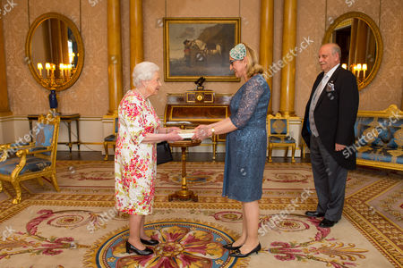 Stock Photo of Ambassador of Georgia Tamar Beruchashvili and Rema Gvamichava meets Queen Elizabeth II during a private audience at Buckingham Palace