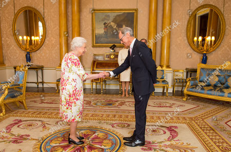 Queen Elizabeth II meets Chief Executive of the Royal Academy of Dance Luke Rittner during the presentation of Queen Elizabeth II Elizabeth II Coronation Award to choreographer Sir Matthew Bourne at Buckingham Palace