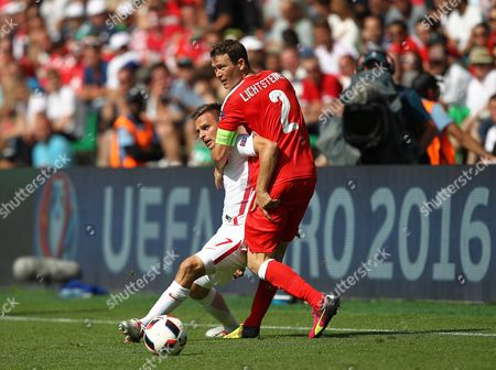 Slawomir Peszko of Poland and Stephan Lichtsteiner of Switzerland    during the UEFA Euro 2016  Round of 16 match between Switzerland and  Poland   played at Stadium Geoffroy Guichard , Saint-Etienne , France on June 25th  2016