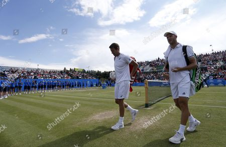 Great Britain's Dominic Inglot and Canada's Daniel Nestor leave the court during the Aegon Open Nottingham Tennis Tournament played at Nottingham tennis, Nottingham on June 25th 2016