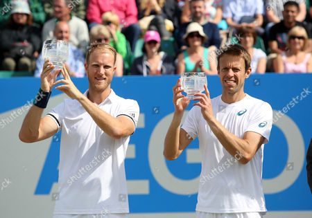 Great Britain's Dominic Inglot and Canada's Daniel Nestor celebrate victory in the doubles during the Aegon Open Nottingham Tennis Tournament played at Nottingham tennis, Nottingham on June 25th 2016