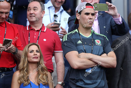 Stock Image of Charlotte Coleman, wife of Wales manager Chris Coleman sits with his son Sonny during the UEFA Euro 2016 Round of 16 match between Wales and Northern Ireland played at Parc des Princes, Paris, France on June 25th 2016