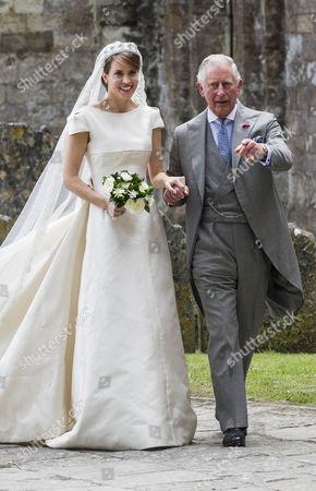 Prince Charles gives Alexandra Knatchbull away.