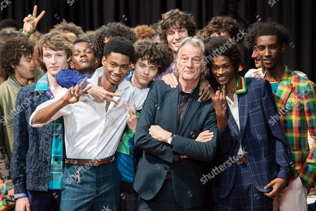 Sir Paul Smith and models on the catwalk