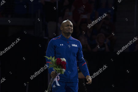 John Orozco reacts as the Rio men's gymnastics team is announced at the U.S. Olympic Team Trials in St. Louis.