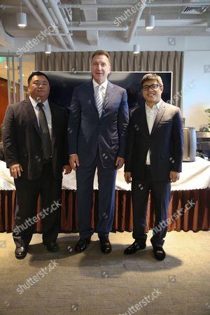(L-R) Liu Hong, co-founder and vice chairman of LeEco, Igor Shuvalov, Xu Xinquan, LeEco's Russian company president.