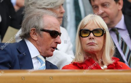 Stock Photo of Sir Jackie and Lady Helen Stewart enjoying the tennis during day one of the 2016 Wimbledon Championships at the All England Lawn Tennis Club, Wimbledon, London on the 27th June 2016