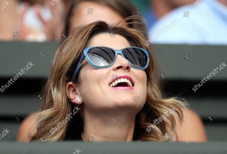 Miroslava Federer smiles as she watches husband Roger Federer during day one of the 2016 Wimbledon Championships at the All England Lawn Tennis Club, Wimbledon, London on the 27th June 2016
