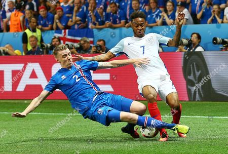 Raheem Sterling of England and Birkir Mar Saevarsson of Iceland during the UEFA Euro 2016 Round of 16 match between  England and Iceland played at Stadium Nice, Nice, France on June 27th 2016