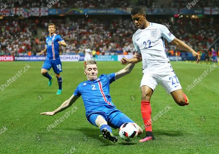 Marcus Rashford of England and Birkir Mar Saevarsson of Iceland during the UEFA Euro 2016 Round of 16 match between  England and Iceland played at Stadium Nice, Nice, France on June 27th 2016