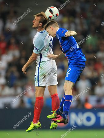 Harry Kane of England and Birkir Mar Saevarsson of Iceland  during the UEFA Euro 2016 Round of 16 match between  England and Iceland played at Stadium Nice, Nice, France on June 27th 2016