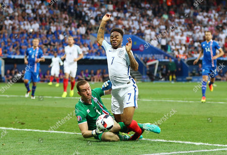 Raheem Sterling of England is awarded a penalty kick from this challenge by Iceland goalkeeper Hannes Por Halldorsson during the UEFA Euro 2016 Round of 16 match between England and Iceland played at Stadium Nice, Nice, France on June 27th 2016