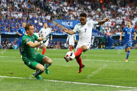 Stock Picture of Raheem Sterling of England and Iceland goalkeeper Hannes Por Halldorsson during the UEFA Euro 2016 Round of 16 match between England and Iceland played at Stadium Nice, Nice, France on June 27th 2016
