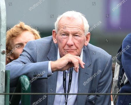 Former Arsenal goalkeeper Bob Wilson watches Katie Swan play during day two of the 2016 Wimbledon Championships at the All England Lawn Tennis Club, Wimbledon, London on the 28th June 2016