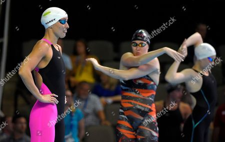 Jessica Hardy, left, waits for her heat to start in the women's 100 metre breaststroke preliminaries