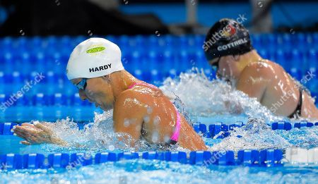 Jessica Hardy, left, leads Andee Cottrell, right, during the women's 100 metre breaststroke preliminaries