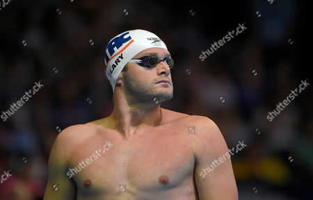 Tyler Clary looks on as he waits to swim in the men's 200 metre freestyle preliminaries