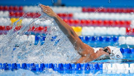 Natalie Coughlin swims during a preliminary heat in the women's 100 metre backstroke
