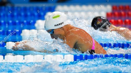 Stock Photo of Jessica Hardy, left, leads Andee Cottrell, right, during the women's 100 metre breaststroke preliminaries at the U.S. Olympic swimming trials