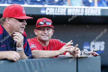 Arizona head coach Jim Morris (right) talks with an assistant coach before game 2 of the NCAA Men's College World Series Championship Finals between Arizona Wildcats and Coastal Carolina Chanticleers at TD Ameritrade Park in Omaha, NE