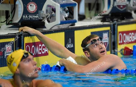 Tyler Clary checks the clock after swimming in a preliminary heat in the Men's 400 metre individual medley