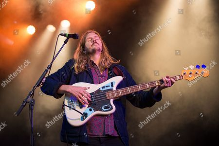 Bass player Jonathon Aherne of Australian rock band The Temper Trap performs