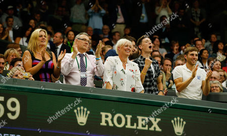Marcus Willis family including his mother Cathy (middle short blonde hair) look on while his girlfriend, Jennifer Bate takes a picture on her phone (sitting far left) during day three of the 2016 Wimbledon Championships at the All England Lawn Tennis Club, Wimbledon, London on the 29th June 2016