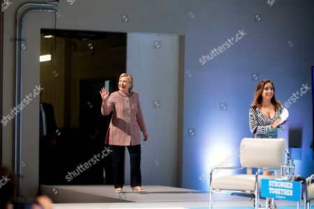 Stock Picture of Democratic presidential candidate Hillary Clinton, accompanied by Dulce Candy, takes the stage to speak at a Digital Content Creators Town Hall at the Neuehouse Hollywood
