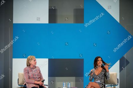 Democratic presidential candidate Hillary Clinton, accompanied by Dulce Candy, right, attends a Digital Content Creators Town Hall at the Neuehouse Hollywood in Los Angeles