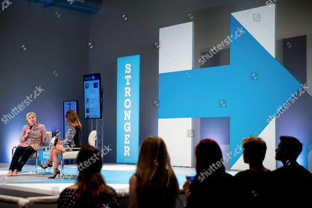 Stock Photo of Democratic presidential candidate Hillary Clinton, accompanied by Dulce Candy, right, speaks at a Digital Content Creators Town Hall at the Neuehouse Hollywood in Los Angeles