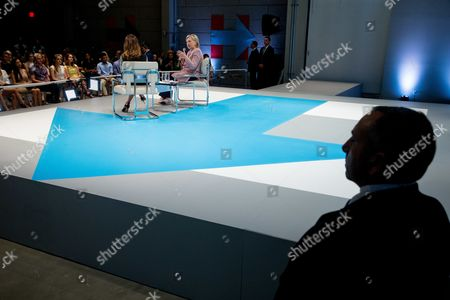 Stock Image of Members of the Secret Service stand nearby as Democratic presidential candidate Hillary Clinton, center, accompanied by Dulce Candy, left, speaks at a Digital Content Creators Town Hall at the Neuehouse Hollywood in Los Angeles