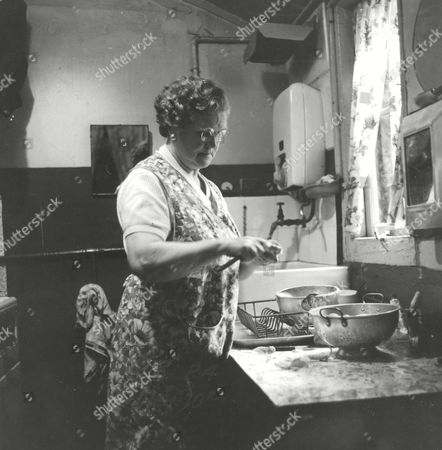 A Day In The Life Of A Char Feature. Mrs Jane Catherine Lacey Of Camberwell London. Jane Pictured Back Home Preparing Lunch For Her Daughter. Box 660 1013011636 A.jpg.