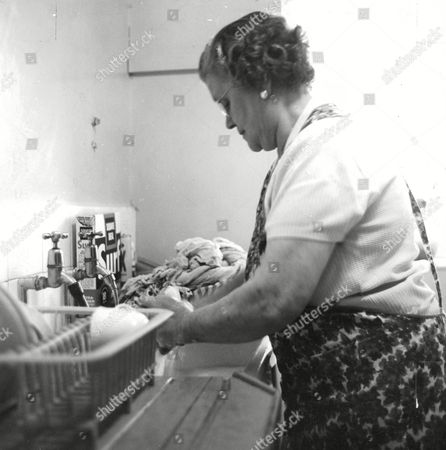Stock Picture of A Day In The Life Of A Char Feature. Mrs Jane Catherine Lacey Of Camberwell London. Jane Back Home Doing Housework. Box 660 1013011629 A.jpg.
