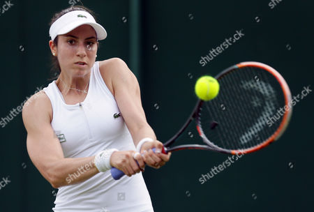 Christina McHale of the U.S plays a return to Daniela Hantuchova of Slovakia during their women's singles match on day two of the Wimbledon Tennis Championships