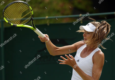 Daniela Hantuchova of Slovakia plays a return to Christina McHale of the US during their women's singles match on day two of the Wimbledon Tennis Championships