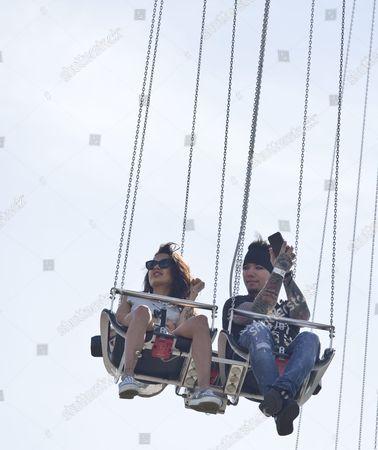 Stock Photo of DJ Ashba with wife Naty Ashba