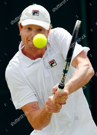 Matthew Barton of Australia returns to Albano Olivetti of France during their men's singles match on day four