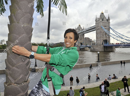 Dame Kelly Holmes brings the sunshine to London and works up a thirst shimmying up a huge 23ft coconut tree at the Vita Coco Coconut Grove in Potters Fields Park, London. The stunning tropical beach hangout is open to all, and Londoners are being encouraged to come down and see if they can match - or even beat - Dame Kelly's time of 6.7 seconds, for the chance of winning an adventurous fun-filled trip.