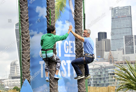 Giles Brook, CEO of Vita Coco Coconut Water, races Dame Kelly Holmes up a 23ft coconut tree at the Vita Coco Coconut Grove in Potters Fields Park, London as part of the brand's #JustGetThirsty campaign. The tropical beach hangout is open to all Londoners who are encouraged to come down and beat Dame Kelly's time of 6.7 seconds.