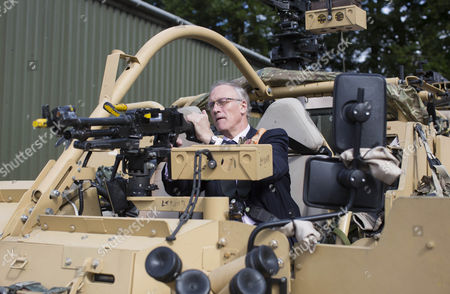 Stock Photo of Defence Minister Julian Brazier, Under- Secretary of State responsible for the Reserve Forces, visits the The Royal Scots Dragoon Guards of Exercise Wessex Storm to view the Army's state-of-the-art JACKAL armoured reconnaissance vehicles.