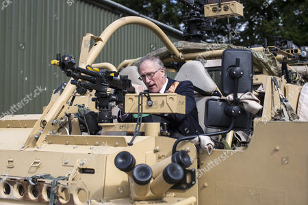 Stock Image of Defence Minister Julian Brazier, Under- Secretary of State responsible for the Reserve Forces, visits the The Royal Scots Dragoon Guards of Exercise Wessex Storm to view the Army's state-of-the-art JACKAL armoured reconnaissance vehicles.