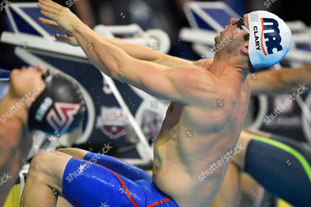 Tyler Clary dives at the start of his heat in the men's 200 metres backstroke preliminaries