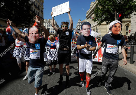 Protesters wearing the mask of French President Francois Hollande, left, French Prime Minister Manuel Valls and Labor Minister Myriam el Khomry demonstrate in Marseille
